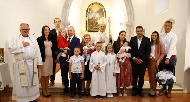 Proslava sv. Augustina i krštenje petog djeteta roditelja Stožicki u Velikoj